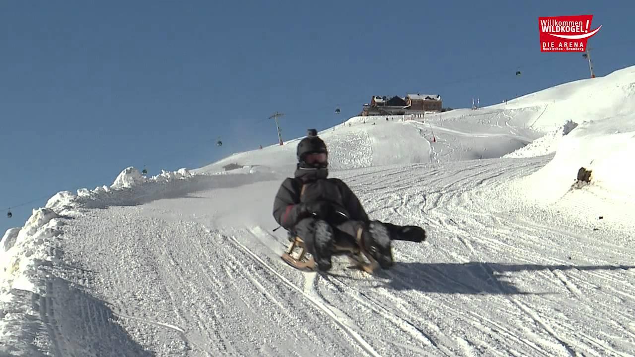 sled on the world u0027s longest floodlit toboggan run in the wildkogel