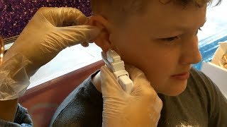 kids getting their ears pierced, brother and sister.