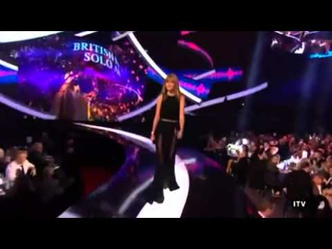 Harry Styles watches as Taylor Swift enters - BRIT Awards 2013