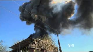 Raw: Military Helicopter Explodes in Ukraine
