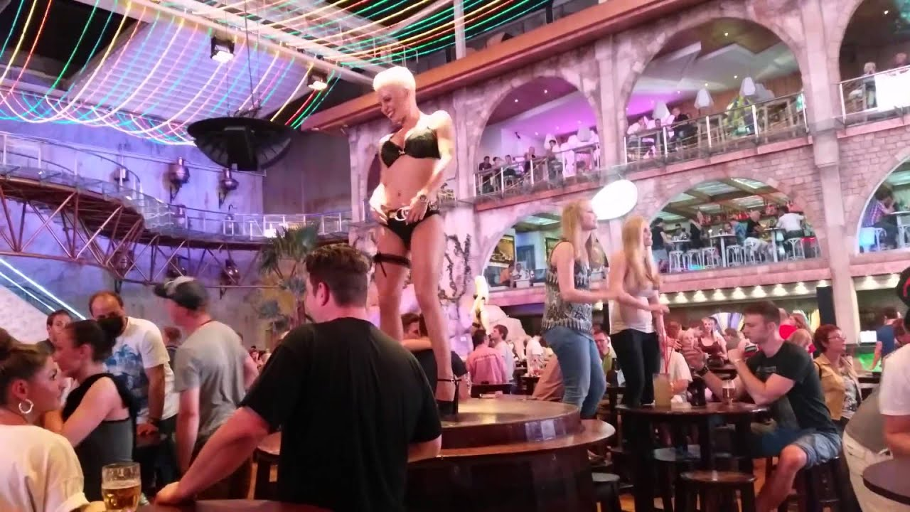 Half naked girls dancing on tables. Mallorca - YouTube