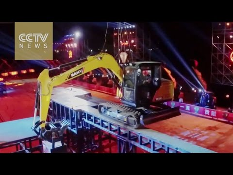 Impossible Challenge: Man drives excavator on 'suspended bridge' on just one track