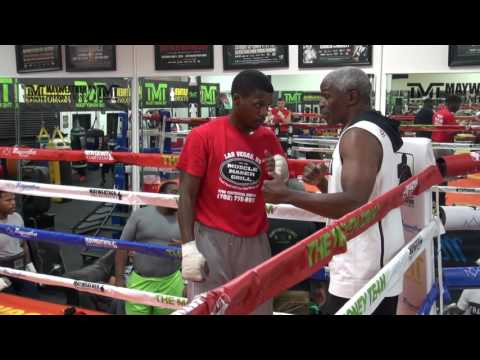 Floyd Mayweather teaching his son Justin Mayweather inside the ring