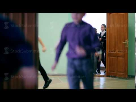 Russia, Novosibirsk, 2015: The bell rings, kids run from the school office