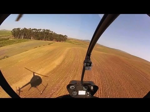 Very Low Helicopter Flying over Africa