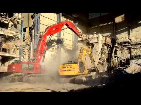 Big powerplant demolition with extreme big demolition excavators of Martens Democom at work.