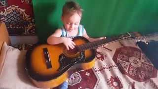 Маленький племяш играет на гитаре)