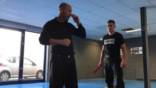 Defending a one hand overhead stick attack, with Amnon Darsa at Institute Krav Maga Netherlands.