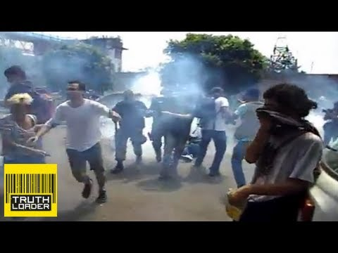 Police fire tear gas and rubber bullets during the eviction of indigenous Brazilians - Truthloader