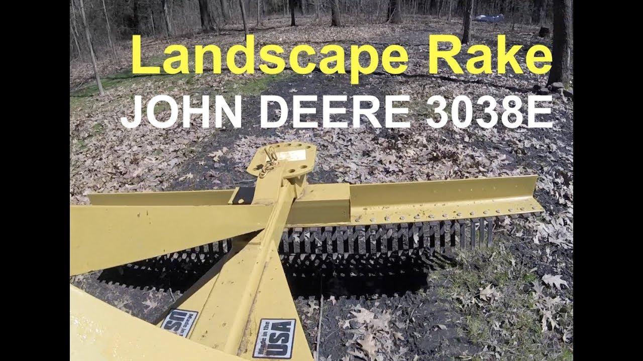 john deere 3038e using landscape rake to pull leaves further into