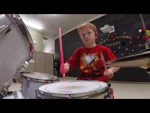 Iron Man 10 year old drumming Starts at 3:35