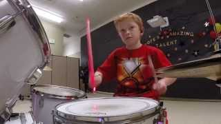 Iron Man 10 year old drumming. Starts at 3:35