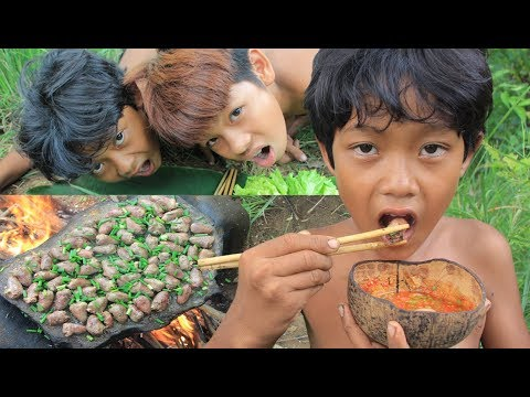 Primitive Technology - Grilled chicken heart on a rock - eating delicious