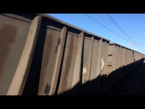 South African Transnet freight train passing Shosholoza Meyl