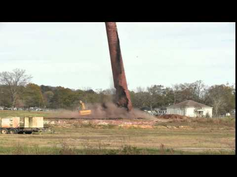 Avondale Mills Smoke stack falls on track hoe operator