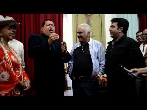 Hugo Chavez sings with famous Mexican musician