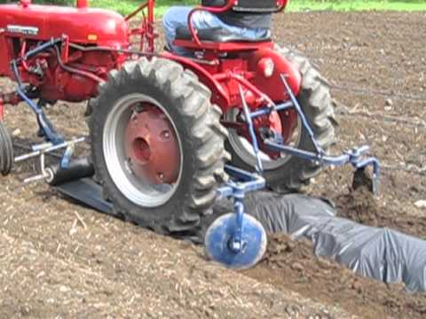 farmall cub lays down weed barrier youtube. Black Bedroom Furniture Sets. Home Design Ideas