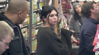 Kendall Jenner has a blast eating a cracker while out shopping in NYC with Pal Hailey Baldwin