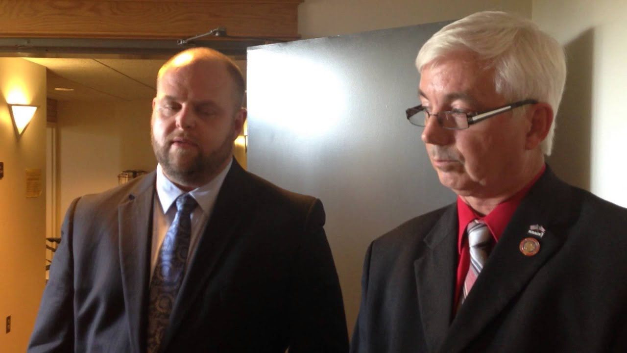 Steve Kraus and his attorney Troy Murphy address the media