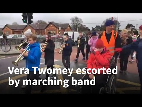 Vera Twomey surprised by marching band during her walk to the Dáil