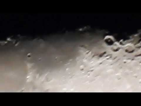 What is the buttonlike object inside one of the moon's crater  P900 zoom
