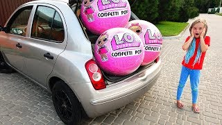 Giant Lol surprise balls in mom's car