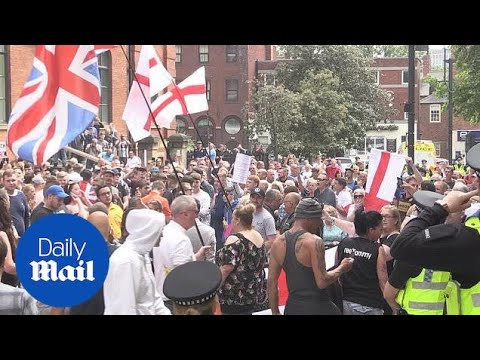 Crowds gather for Free Tommy Robinson protest in Leeds - Daily Mail