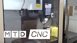 Extra Y axis, new larger viewing window and a universal swarf conveyor on VMC
