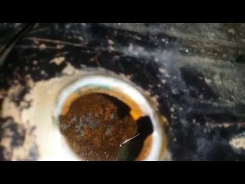 How to clean out a rusty tank easy way!!!!!