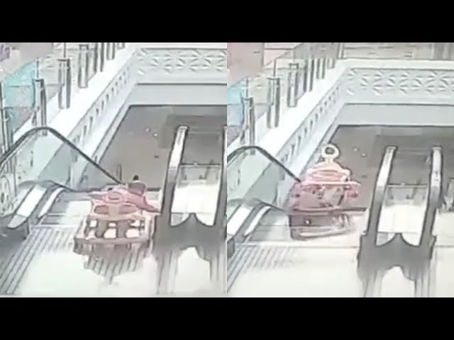 Heart-stopping moment after toddler falls on escalator