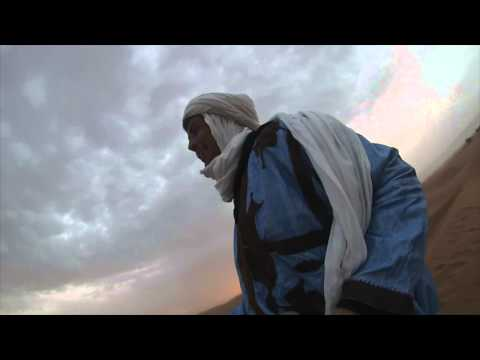 Sandboarding at the dunes of Chegaga, Morocco - with Zbartravel