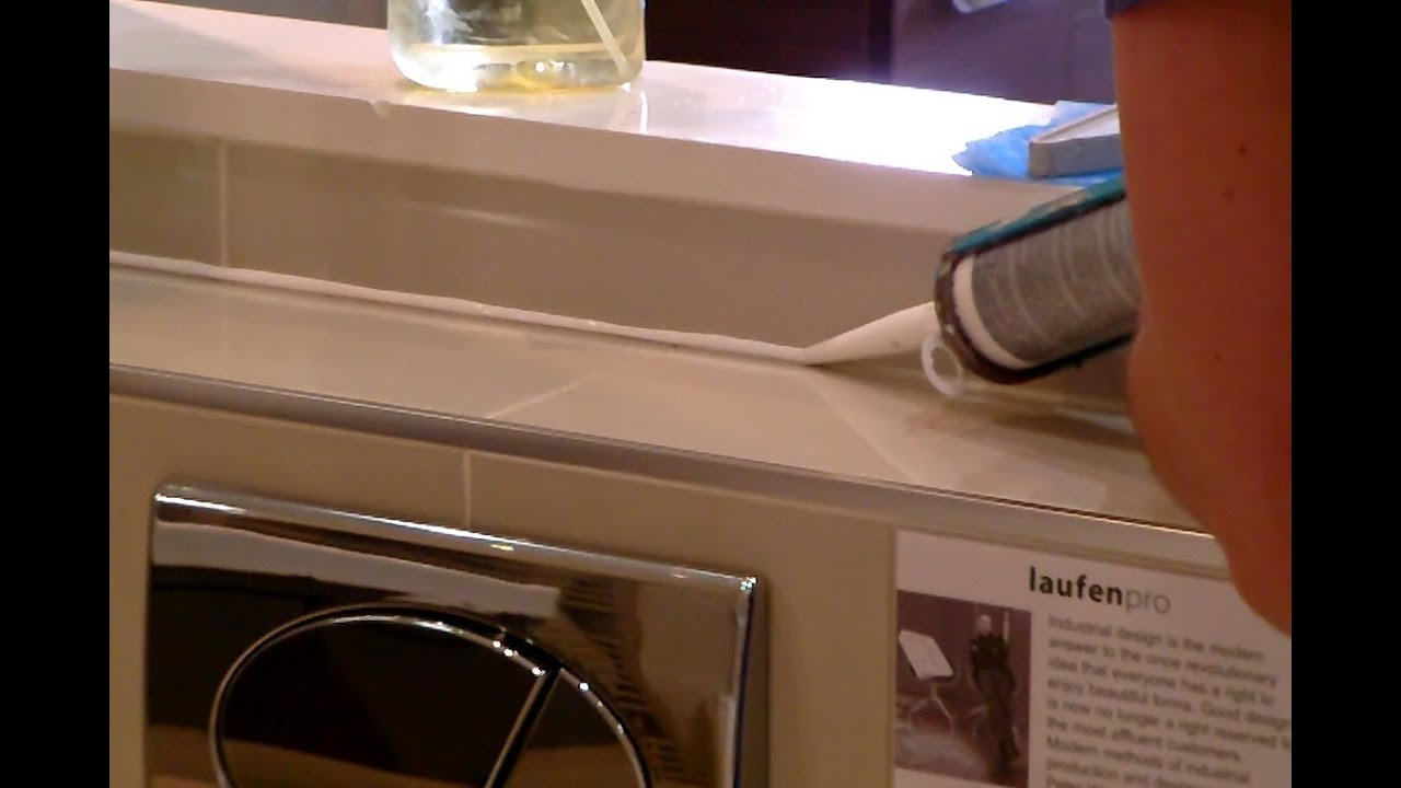 How To Caulk A Bathroom Sink how to silicone / caulk a bathroom without using masking tape