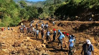 Grim search for typhoon landslide victims in Philippines