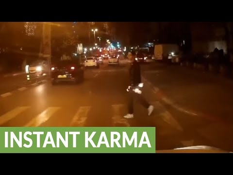 Driver receives instant karma after nearly hitting pedestrian
