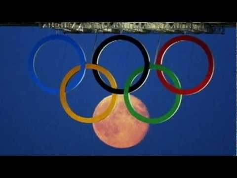 Beautiful pictures as the Moon rises behind London 2012 Olympic rings at Tower Bridge