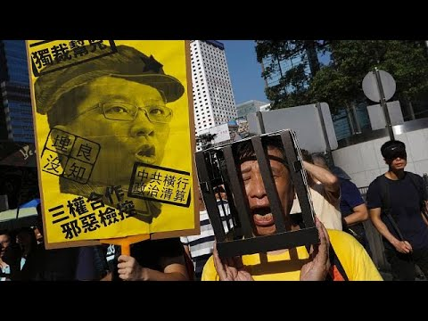 Tens of thousands protest jailing of Hong Kong democracy leaders