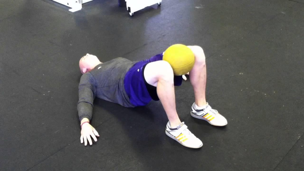 Hanging knee raises with medicine ball - Hip Bridge W Med Ball Squeeze