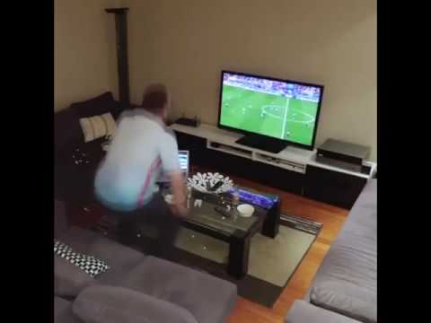 Wife turns off tv while husband watching Soccer prank
