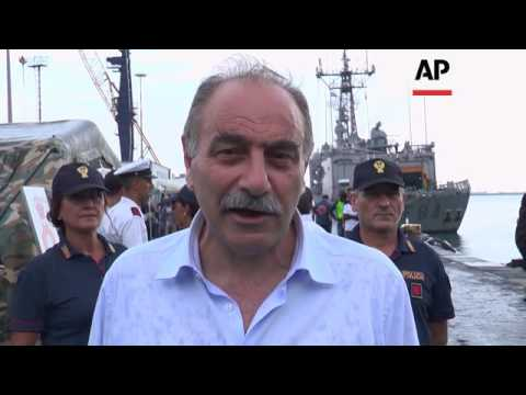 Migrants disembark from Spain navy ship in Italy