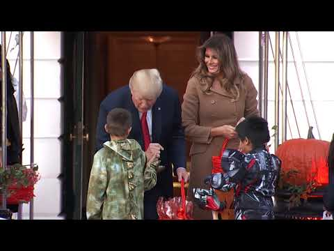 Trump and first lady welcome dinosaur, skeletons on Halloween eve