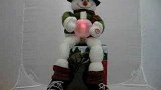 Christmas Lighting Ornament Toys: Wiggle snowman sings Christmas carols Jingle Bell with lights