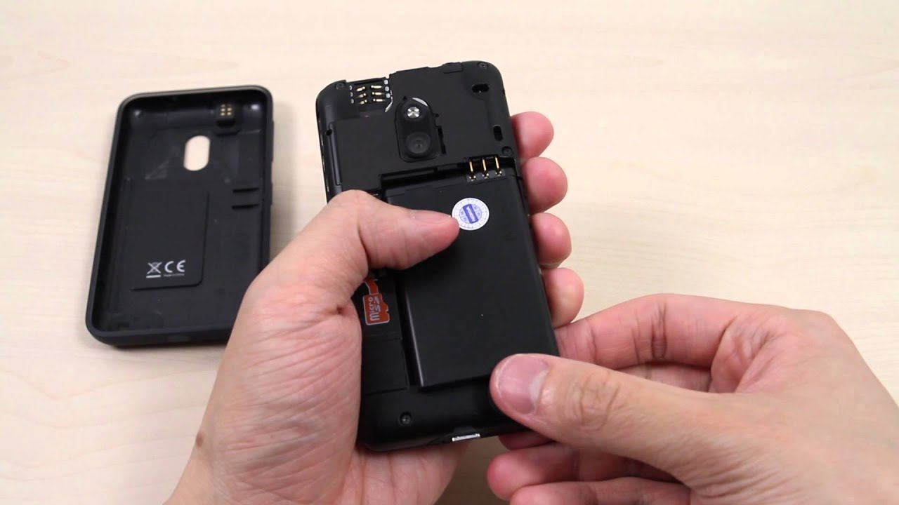 How To Insert And Remove The Micro Sim Card On Nokia Lumia 620 Youtube