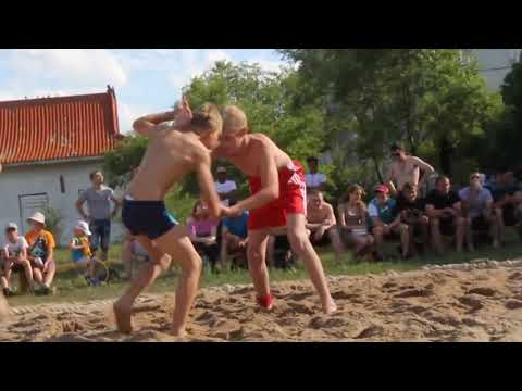 Sand Wrestling - Young Boys