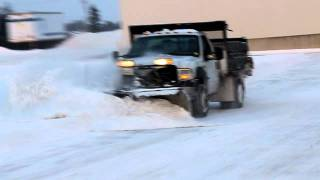 Dump Truck with V-Plow and Salter perfroming Snow Removal in Kitchener Ontario Canada Snowman.ca