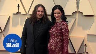 Krysten Ritter flaunts baby bump in skin-tight dress at Oscars