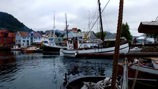 Old boat Selma in small harbour next fisherman museum in Bergen
