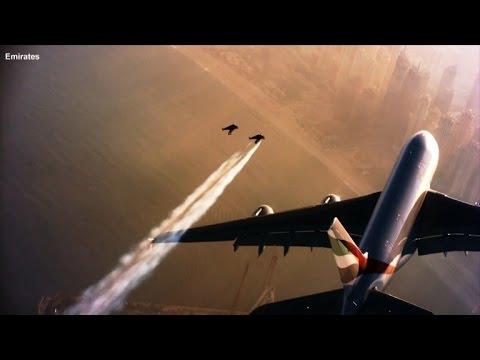 Watch Men Wearing JetPacks Incredibly Fly Alongside A Jumbo Jet - Crazy video of two guys flying jetpacks over dubai
