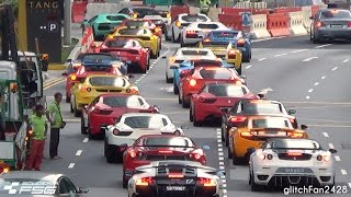 Maxson Goh Films a traffic jam of supercars in Singapore from the S...