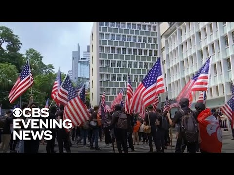 Hong Kong Protesters Wave American Flags Asking For Help