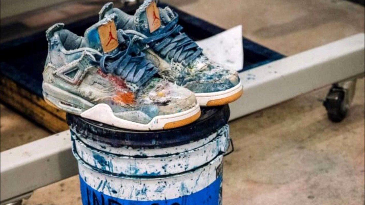 db194df1fb0 Distressing the Levi's x Air Jordan 4 Jordan Brand tapped artist Julian  Gaines to customize a pair